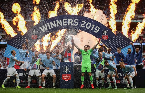 Manchester City players celebrate their FA Cup triumph but will be hoping for more success next year