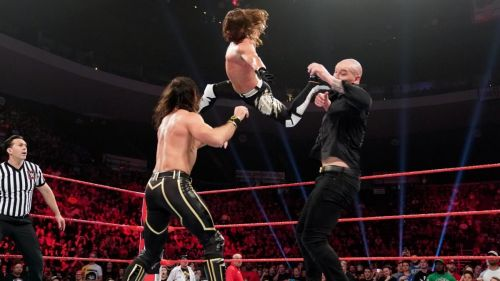 Styles left Rollins in the ring after hitting the Phenomenal Forearm