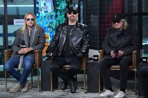 Rob Halford (center) and Judas Priest bandmates visit Build on March 31, 2018