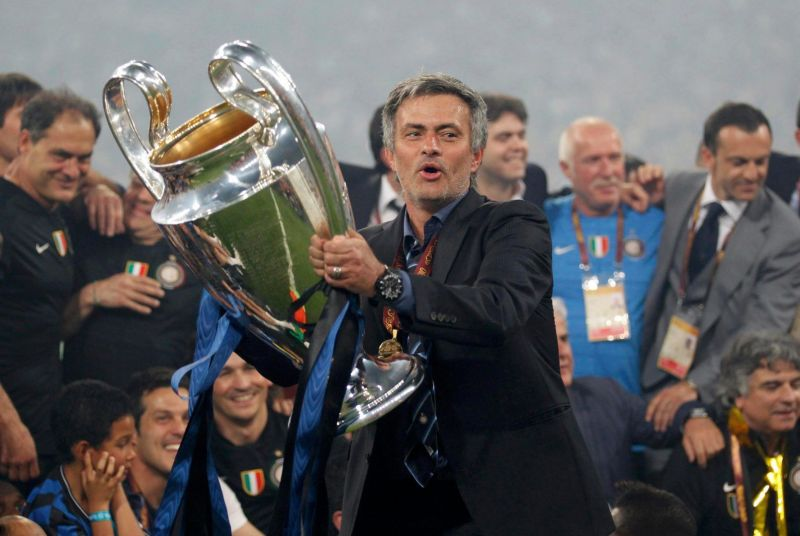Mourinho with the Champions League title he won with Inter Milan in 2009-10