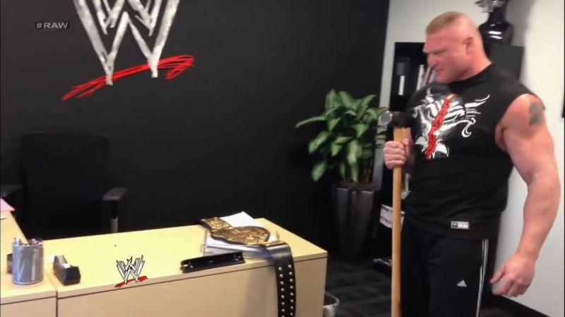 Brock Lesnar holding Triple H