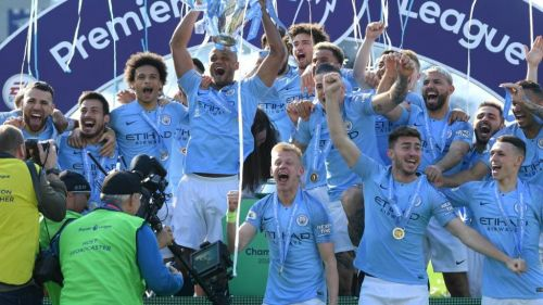 The jubilant City team with the trophy