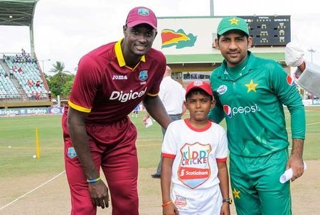 Jason Holder and Sarfaraz Ahmed