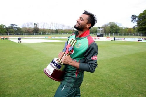 Mashrafe Mortaza relishes with Tri-series trophy.