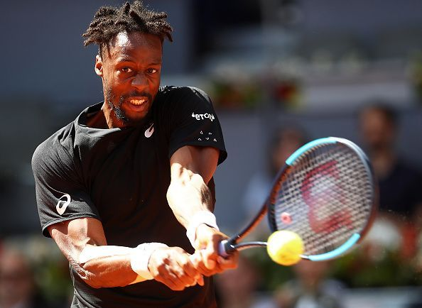Monfils in action against Roger Federer at the Mutua Madrid Open their 3rd round match at the Mutua Madrid Open 2019