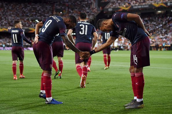 The pair celebrate one of their goals during Arsenal