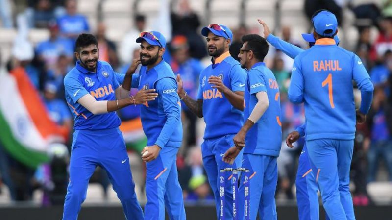 Men in Blue rejoicing after defeating Proteas