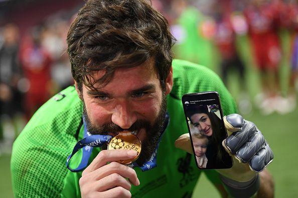 Alisson Becket celebrates his Champions League win.
