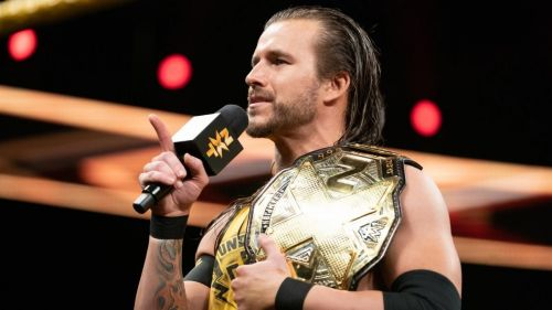 The crowd seems divided on Adam Cole as the Champ!