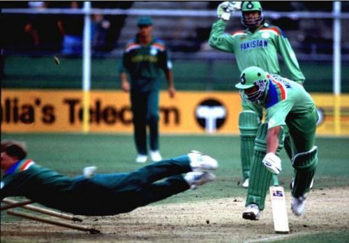 Jonty Rhodes going airborne and into the stumps to run-out Inzamam.