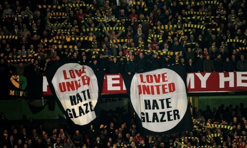 Anti-Glazer banners dangling over the stands at Old Trafford.