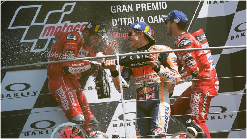 Andrea Dovizioso and Marc Marquez celebrate with Danilo Petrucci