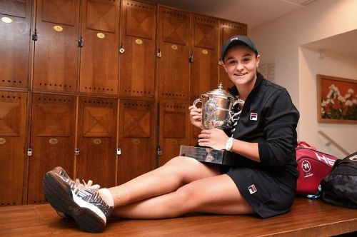 Barty celebrates with her French Open title after a straight-sets victory over Vondrousova