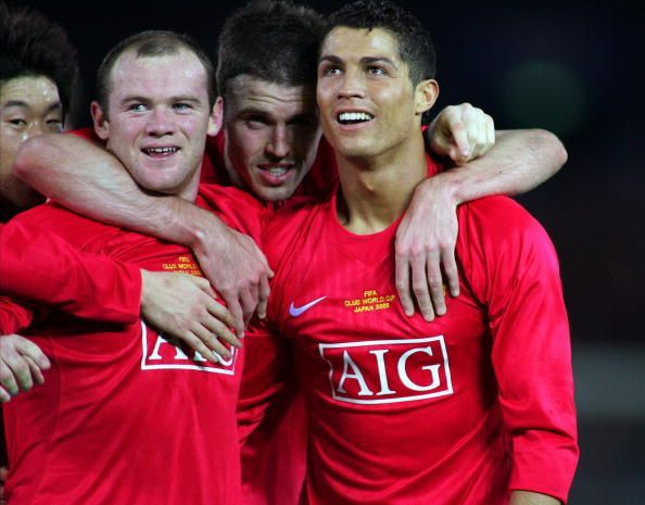 Wayne Rooney alongside Cristiano Ronaldo during their playing days at Manchester United