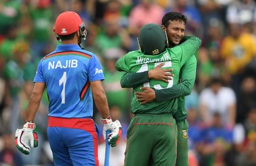 Bangladesh's two pillars, Shakib Al Hasan and Mushfiqur Rahim celebrating Najibullah Zadran's dismissal