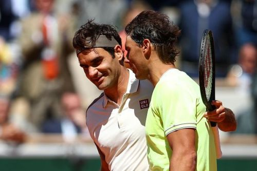 Federer and Nadal embrace each other after the match