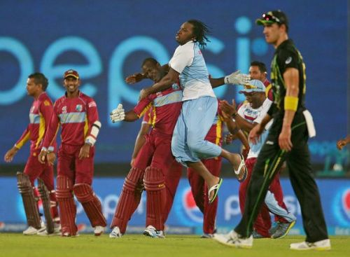 Mitchell Starc looks on as the West Indians celebrate