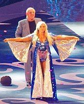Flair being accompanied by her father Ric Flair