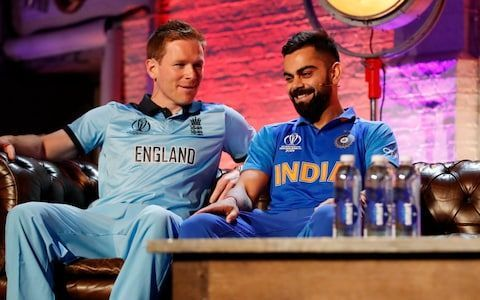 Eoin Morgan having a candid conversation with Virat Kohli