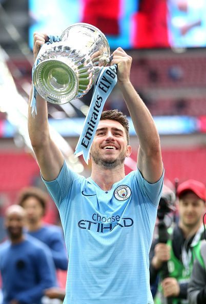 Laporte lifts the FA Cup with Manchester City.