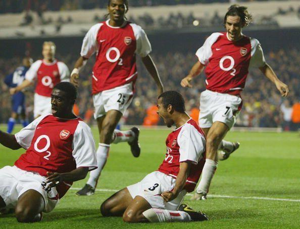 Ashley Cole celebrates scoring the winning goal