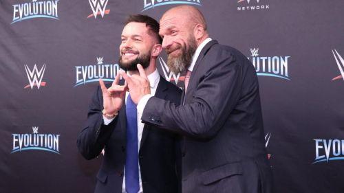 Finn Balor and Triple H share a Too Sweet