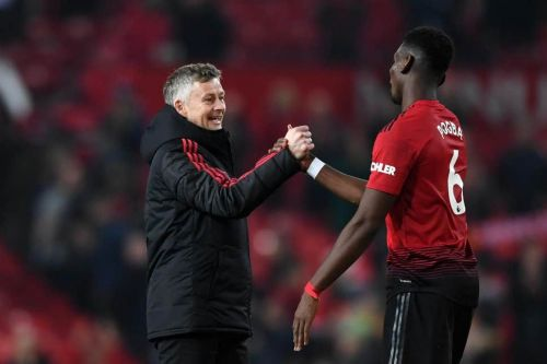 Utd's Manager Ole Gunnar Solskjaer and Paul Pogba