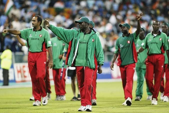 Steve Tikolo, captain of Kenya leads his players on a lap of honour