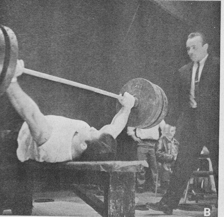 A young Bruno Sammartino attempting a massive bench press.