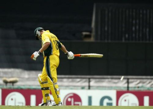 Adam Gilchrist of Australia shows his disappointment after being run out for 99