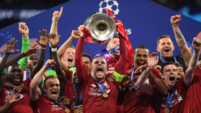 Liverpool players celebrating their triumph
