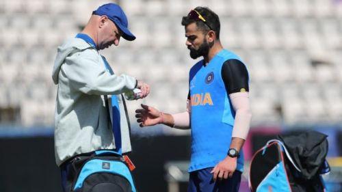 Team India's physiotherapist Patrick Farhart was seen applying spray on Kohli's right thumb