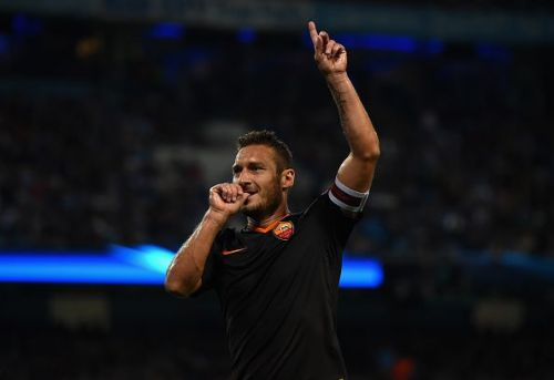 Totti strikes a familiar pose