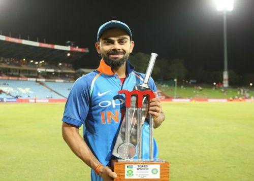 Virat Kohli with The Momentum series trophy, 2018.