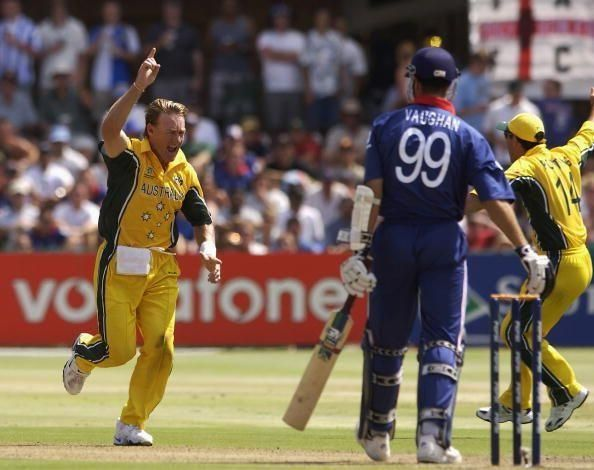 Andy Bichel of Australia celebrates the wicket of Michael Vaughan of England