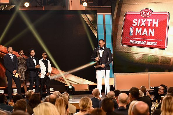Eric Gordon (pictured, centre) during the 2017 NBA Awards with his accolade for Sixth Man of the Year