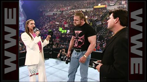 In-ring negotiation with Triple H at Vengeance 2002.