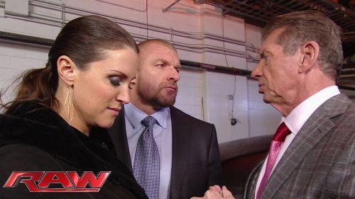 Triple H, Stephanie McMahon, and Vince McMahon