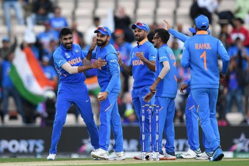 The Indian Team celebrates the fall of a wicket