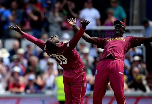 West Indies' Sheldon Cottrell celebrating with a teammate