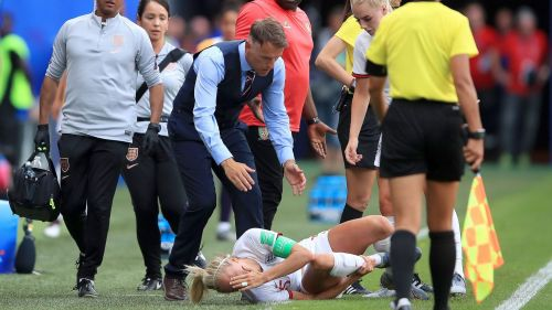 Phil Neville attends to stricken England captain Steph Houghton