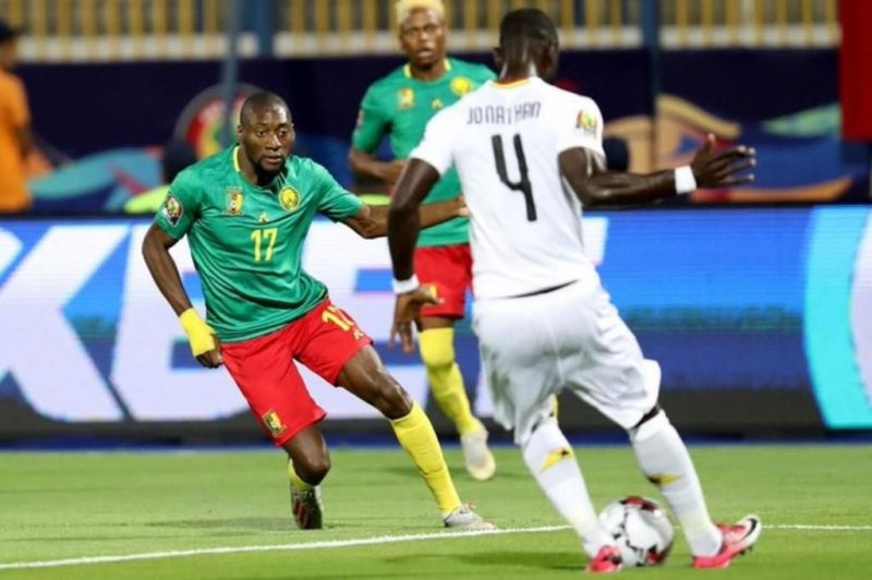 Jonathan Mensah (r), he played a crucial role in keeping the rampaging Indomitable Lions attack at bay
