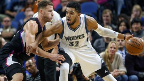 Timberwolves' Karl-Anthony Towns posting up Blake Griffin