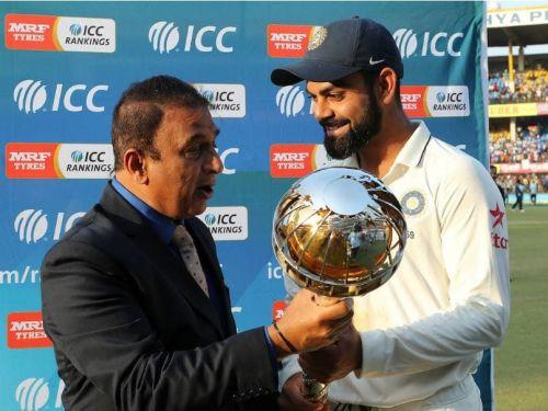 Virat Kohli with the Test mace