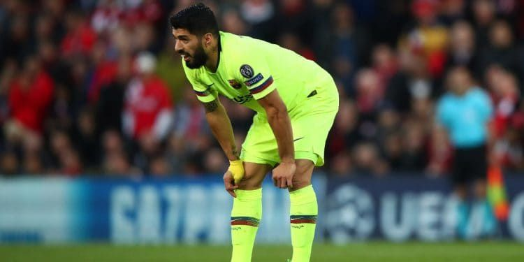 A dejected Suarez after the Champions League exit against Liverpool at Anfield