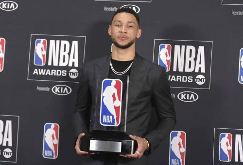 Ben Simmons flaunts his Rookie of the Year award