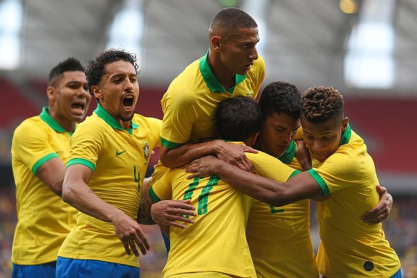Brazil team-members celebrate after Coutinho made it 3-0