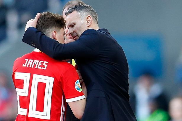 Daniel James alongside Wales manager and United legend Ryan Giggs