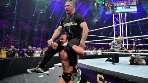 Shane McMahon and Drew McIntyre celebrating