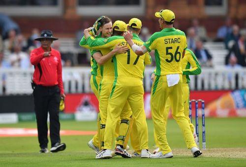 Jason Behrendorff celebrating a wicket with his teammates